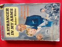 Paperback book from 1950s. A Stranger in my Arms by Robert Wilder
