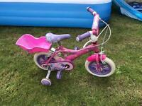 Girls bike with stabilisers and dolly holder