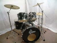 Retired drum teacher has a Gretsch Blackhawk drum kit with Sabian cymbals for sale.