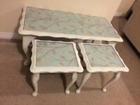 Glass top coffee table with two small tables