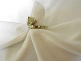 Stunning unusual Platinum Engagement Ring