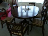 Large dining table and six chairs, with extension panel