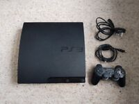 Sony PlayStation 3 Slim 160GB Charcoal Black Console + 5 Games, Boxed.