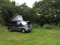 Space to store and restore camper vans (part time)