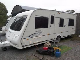 2008 Compass Omega 544, 4 berth caravan with fixed bed and starter kit.
