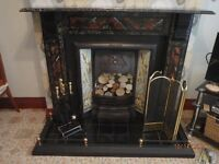 Original Victorian cast iron fireplace with tiled insets and marbleised slate surround and mantle.