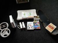 Nintendo Wii and Wii fit with 2 controllers, steering wheels and games