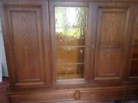 Large living room display cabinet with side cupboards and draws