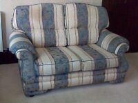 Three piece Suite with matching Footstall (Manufacturer: Reid)
