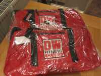 2 x DW sports bags/holdalls in red - New, never used, still in packaging, 22 inches x 14 inches