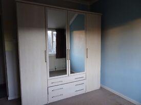 Large maple-veneer 4 door wardrobe in good condition