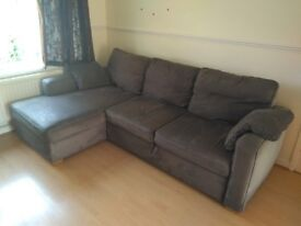corner sofa with chaise longue and extendable base, in gray velour
