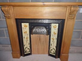 Ornate cast iron fireplace and matching wooden pine surround. 118 cm x 137 cm