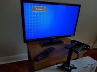 Unused 24 inch HD LED TV with Freeview & wall mounting bracket.