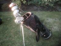 Golf clubs-Taylormade Driver, Wilson 3 & 5 Woods, Wilson Irons, Putter, Bag, Glove, Balls & Tees