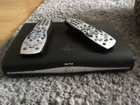 Sky box & 2 remote controls