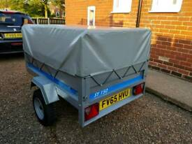 TRAILER WITH HIGH SIDED COVER AND FRAME.