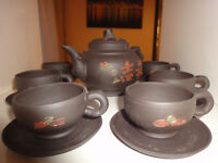 japanese tea pot set with in a mat black colour and coloured motifs