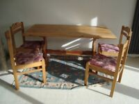 Pine table and 4 upholstered chairs