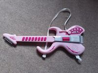 Childs toy pink guitar