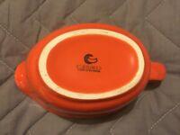 Used orange serving jug