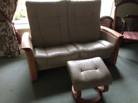 Leather settee with footstool.