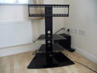 TV Stand: Black Cantilever Swivel with Two Glass Shelves. TV height adjustable.