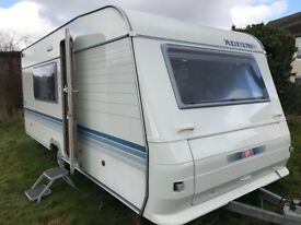 Adria Altea lightweight 5 berth caravan with fixed bunk beds and full awning