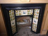 Antique, ornate, cast iron, tiled fire place with a beautiful hand crafted solid Oak surround