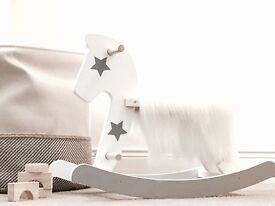 Rocking horse. Wooden rocking horse. White and grey. Playroom, nursery. Kids Christmas present.