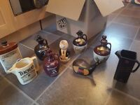 Collection of whiskey and cognac ceramic pouring jugs