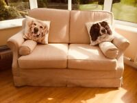 TWO SEATER SOFA BED .