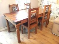 Beautiful Indian wood dining table and 6 chairs