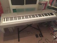 Yamaha P60S (silver) with black X-frame Quik-Lok stand