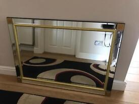 Large mirror with surround