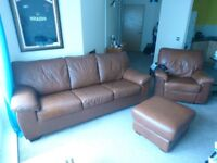 Brown leather sofa with fold out bed (never used) with armchair and foot stool