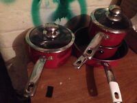 Set of 4 red pans for sale