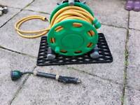 20 metre HOSE & REEL complete with TAP Connection and MULTY SPRAY ETC. HEAD