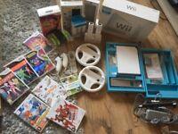 Nintendo Wii bundle, 7 games. Steering wheels, 2controllers. Zumba belt. All boxed.