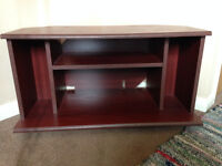 Small mahogany effect TV corner unit with storage shelf
