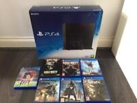 Playstation 4 with controller and games