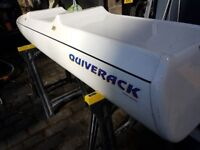 Quiverack windsurfing roof box. Holds a board and three sails.