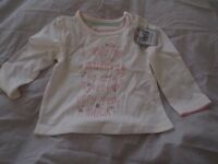 Selection of newborn baby girl clothes