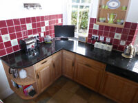 Black granite (Peacock) worktops. 30mm.