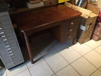 Teak coloured desk with draws