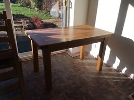 Solid wood dining table and 6 chairs