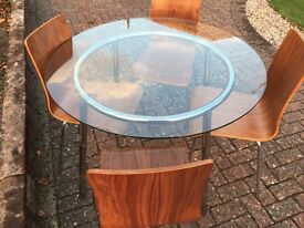 Glass round table + four chrome & chestnut contemporary chairs