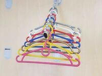 CHILDREN'S PLASTIC COLOURED COAT CLOTHES HANGERS WITH TROUSER BAR