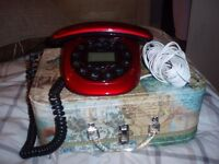 red house telephone and long cord