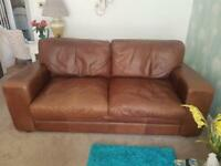 Excellent condition. Large three seater, chair and matching footstool